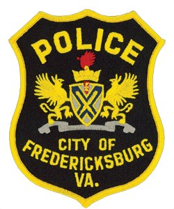 The city of Fredericksburg, Virginia is rich in history. The patch of its police department contains many symbols that honor its British colonial heritage and its significant role in America's past, present, and future.