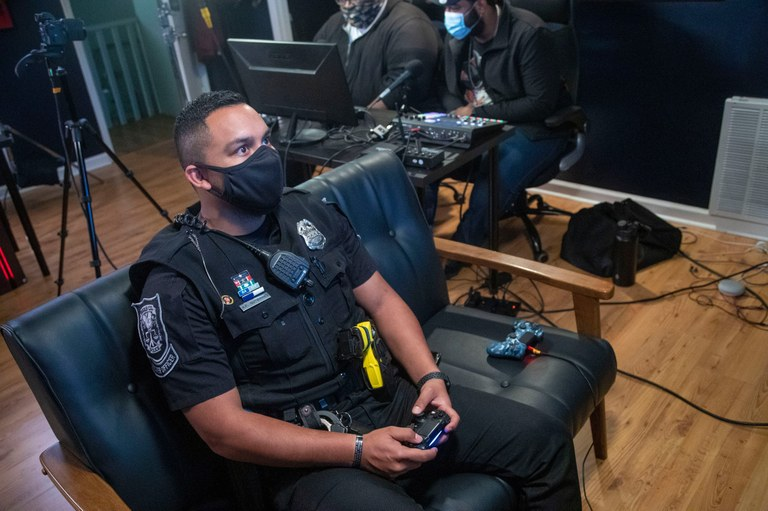 An image of a DeKalb County officer playing video games online.