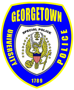 "The seal of Georgetown University, located in Washington, D.C., is prominently depicted on the service patch of the campus police department. A vertical, oval-shaped design, the seal features a bald eagle with its wings spread beneath a glowing lyre, grasping a globe with its right talon and a cross with its left. The scroll in the eagle's mouth bears the words ""Utraque Unum,"" meaning ""both into one."" The seal bears 16 stars, which dates it between 1796, when Tennessee became the 16th state, and 1803, when Ohio was admitted as the 17th state. Georgetown University Police Department officers are commissioned special police vested through the Metropolitan Police Department with full police capabilities on campus property."