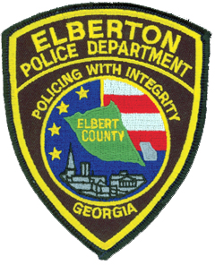 "The traditionally shaped patch of the Elberton, Georgia, Police Department prominently features the city's seal in its center. The middle depicts an outline of Elbert County, for which Elberton is the seat of government, along with a smaller outline of the state. The red and white stripes against a blue background with stars embody the patriotic sentiments of the community. At the foreground of the seal is a representation of the city's churches, courts, and granite industry. Elberton is considered the ""Granite Capital of the World,"" producing more granite products annually than anywhere else."