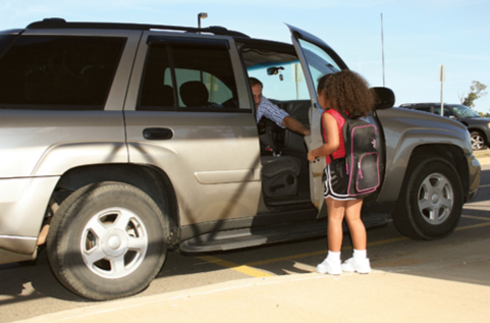 Stock image of a young girl entering the car of a potential abductor. © Thinkstock.com
