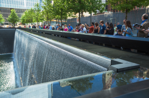 A view of the 9/11 Memorial fountain in New York City.