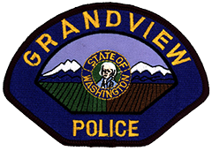 The Grandview, Washington, Police Department's patch features the state seal in its center. In the foreground, lush green fields and rich deep-brown soil represent the fertile Yakima Valley. In the background, Mount Adams and Mount Rainier signify the origins of the city's name.