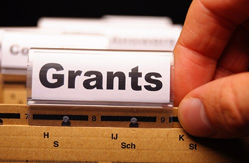 Stock image of a file folder with a Grants label.