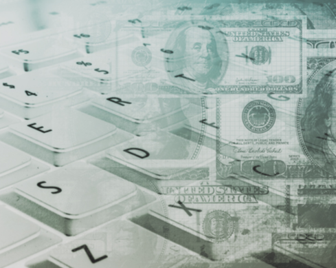 Cash and Computer Keyboard (Stock Image)