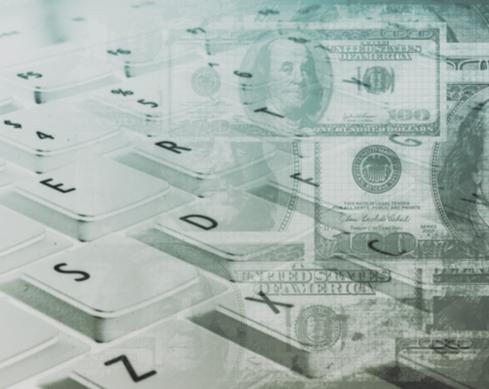 Stock image of money superimposed on computer keys. © Thinkstock.com