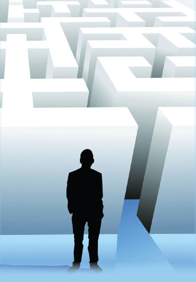 Silhouette of Man Standing Outside White Maze (Stock Image)