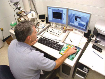 An individual in the Hamilton County Coroner's Office in Cincinnati, Ohio using the scanning electron microscopy/energy dispersive x-ray spectrometry system.