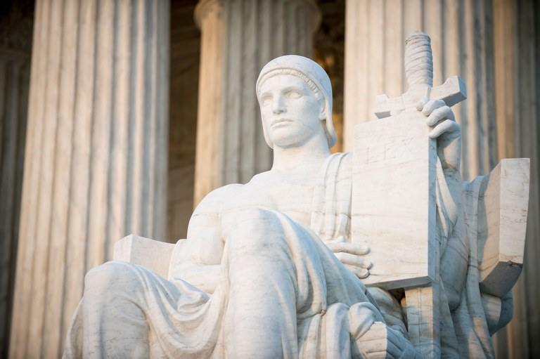 A stock image of the Guardian statue located in front of the U.S. Supreme Court Building.