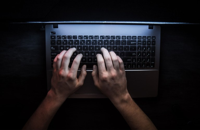 A stock image of hands typing on a laptop.