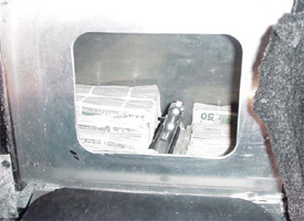 Hidden Compartment with Cash in Vehicle