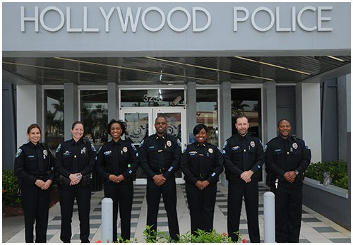 Seven school resource officers in the Hollywood, Florida Police Department in front of the department building.