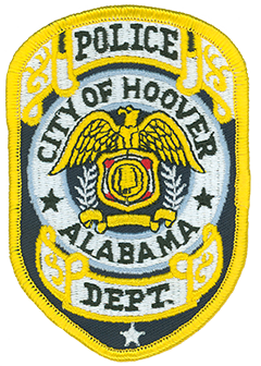 The city of Hoover, Alabama, was founded in 1954 by William H. Hoover, Sr., a local insurance salesman and developer, and incorporated on April 28, 1967. Growing from a population of 406, the city today has over 84,000 residents and is the largest suburb of Birmingham, Alabama's largest city. The Hoover Police Department, founded in 1967, currently employs 166 officers and 62 civilian staff members. The department's service patch features intricate scrollwork with gold edging at the top and bottom. In the center is a bald eagle with its wings spread over a shield. Within the shield is the Great Seal of Alabama, featuring a map of the state with its major rivers.