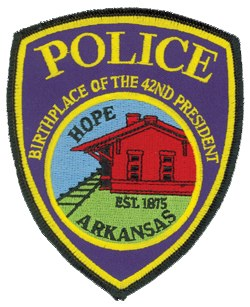 The patch for the Hope, Arkansas, Police Department depicts the city's oldest building, its 1912 train depot, adjacent to railroad tracks. These serve to represent the commerce and social growth brought to Hope's downtown area by the railroad since 1875, the year the city was established. The patch also proudly indicates that Hope is the birthplace of the 42nd President of the United States, Bill Clinton.