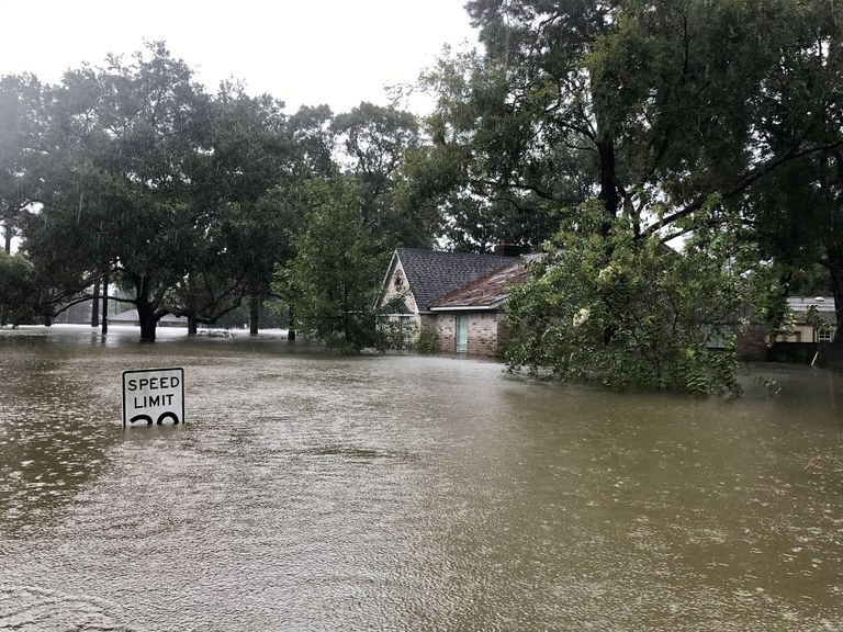 A stock image of a house under water from the flooding after Hurricane Harvey.