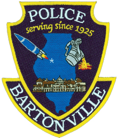 In the background of the Bartonville, Illinois, Police Department patch is an outline of the state with a star indicating Bartonville's location. The rocket depicted on the left is the symbol of Limestone Community High School, whose art students designed the patch, while the steel ladle on the right represents the Keystone Steel and Wire Company. The large building at the bottom represents the Peoria State Mental Hospital, opened in 1902 and closed 70 years later.