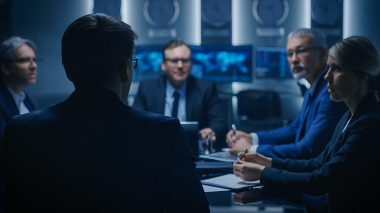 A stock image of a group of executives meeting.
