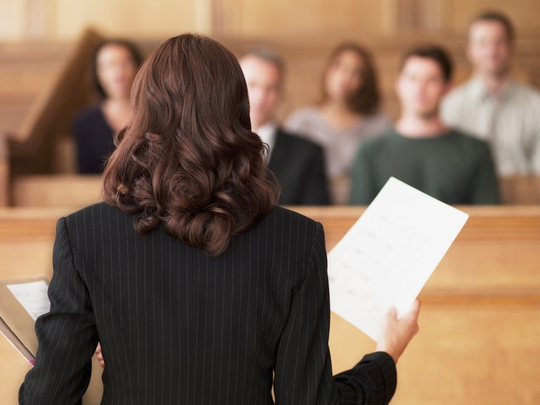 A stock image of a lawyer speaking to a jury.