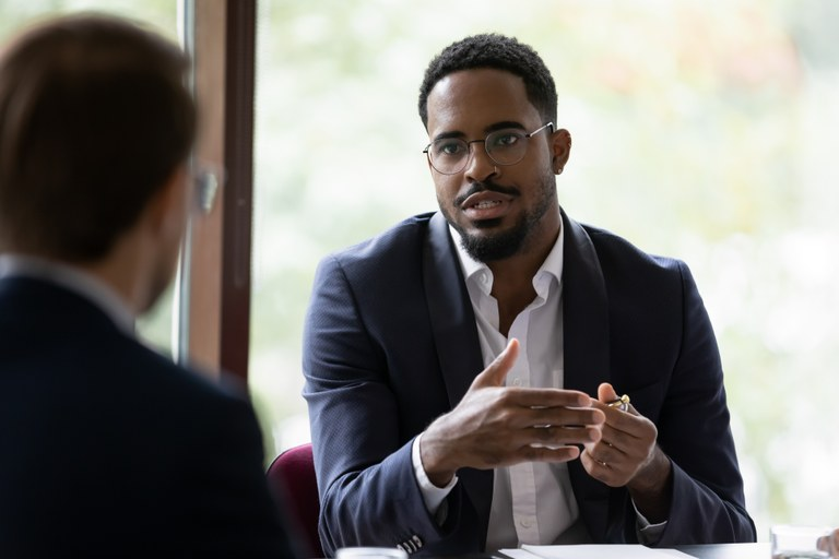 A stock image of two men having a conversation.