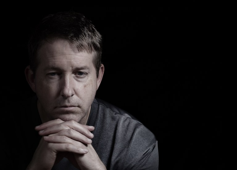 A stock image of a depressed middle-aged man.