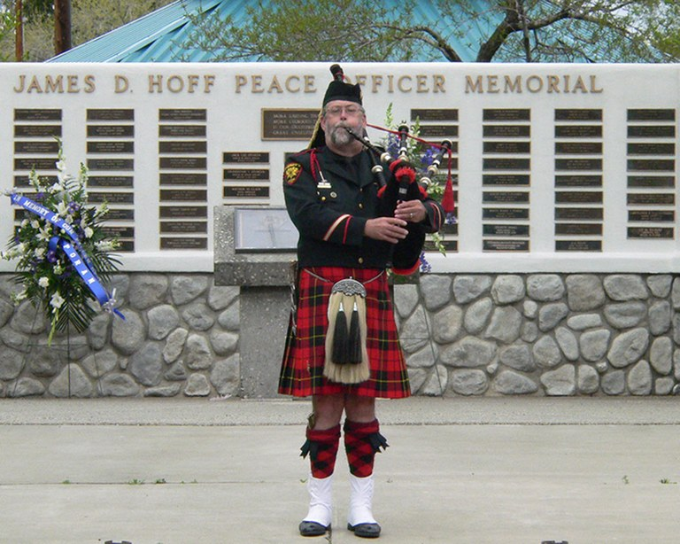 A bagpiper in front of the James D. Hoff Peace Officer Memorial located in Reno, Nevada.