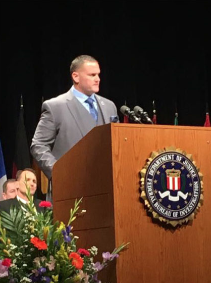 Assistant Chief Taylor of the Dallas-Fort Worth, Texas, Airport Police Department delivers a speech at the FBI National Academy Session 267 graduation on March 17, 2017, in Quantico, Virginia.