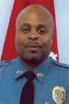 Sergeant Elijah McGee of the Rock Hill, Missouri Police Department kept flames from engulfing the driver of a vehicle that had crashed and was on fire. McGee was a Bulletin Notes recipient in June 2010.