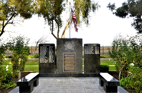 The Kern County Sheriff's Office Memorial, located in a park area east of the sheriff's office headquarters in Bakersfield, California, was unveiled on October 30, 2002. The monument consists of granite pillars engraved with the names of 31 sheriff's office sworn and volunteer personnel who paid the ultimate sacrifice from 1873 onward while serving the citizens of Kern County.