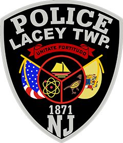 "The center of the Lacey Township, New Jersey, Police Department's patch depicts the agency's original one, which also doubles as the township's official seal. The three sections represent Lacey Township's unique features. A sailboat symbolizes the recreational fishing and boating the area is known for. The pheasant depicts the Forked River Game Farm, which raised wild pheasants for release in wooded areas throughout New Jersey for hunting. An atom acknowledges that Lacey Township is home of the oldest operating nuclear power plant in the nation. The United States and New Jersey flags also are represented. The Latin phrase Unitado fortitudo translates to ""Strength through unity."""