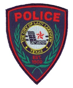 The patch of the Lacy Lakeview, Texas, Police Department has a blue background, representing awareness, persistence, and justice; the red letters reflect bravery and resilience; and the white circle indicates purity and innocence. An olive branch surrounds the city's emblem. The red and white star symbolizes the department's commitment to its community.