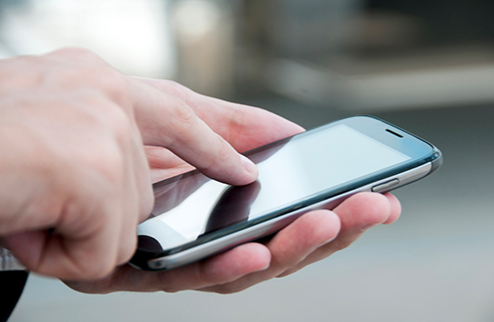 Stock image of a person using a cell phone.