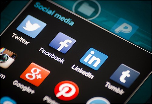 Various social media apps like Twitter, Facebook, LinkedIn, and Tumblr on a cell phone.