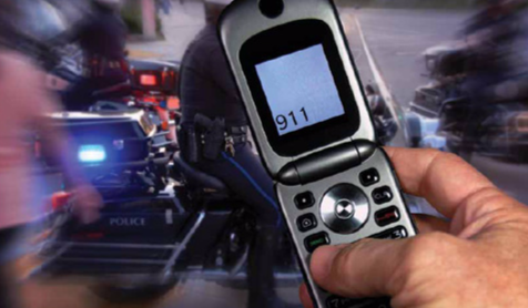 A mobile phone is depicted dialing 911 for an emergency.