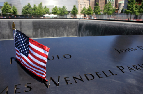 Names at 9/11 Memorial with Flag