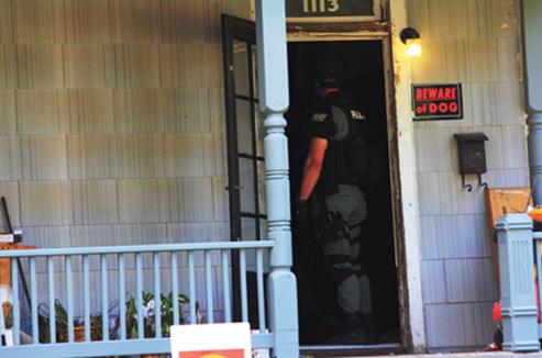 Officer Entering House
