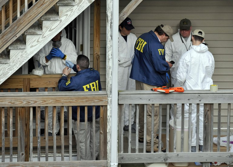 FBI agents and other personnel search a house where Faisal Shahzad lived in Bridgeport, Connecticut on May 4, 2010. Shahzad pleaded guilty to all counts of a 10-count indictment for driving a car bomb into Times Square on the evening of May 1, 2010. AP Photo.