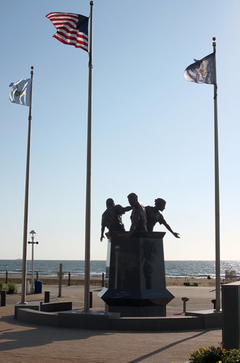 The Virginia Beach Law Enforcement Memorial was dedicated on June 23, 2012. The memorial was created by Paul DiPasquale, the same sculptor who created Virginia Beach's iconic statue of King Neptune. It features three police officers, sculpted in bronze, who represent the Virginia Beach Police Department, Virginia Beach Sheriff's Office, and state and federal law enforcement agencies.
