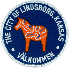 On the left sleeve of the Lindsborg, KS, Police uniform is the city of Lindsborg seal, prominently featuring the Dala horse.