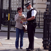 London Police Officer Helping Civilian