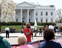 A protest at the White House is led by a man on a megaphone. © Jim Pruitt/Shutterstock.com.