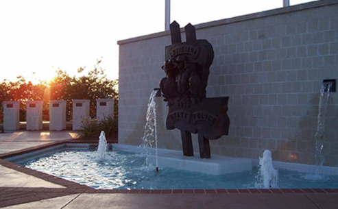 Depiction of statuary at the Louisiana State Police Memorial.