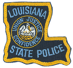 "The Louisiana State Police was created in 1936 when the state legislature combined the highway patrol with the bureau of criminal investigation. The shoulder patch of the Louisiana State Police dates back to its founding year. Its patch forms the ""boot,"" or ""L,"" shape of the state. The department is one of only four state police agencies nationwide to fashion its patch in the outline of the state it serves. Within the patch is the Louisiana State Seal, featuring a pelican—the state bird—in a nest feeding three of its young. Surrounding the seal are the words ""Union, Justice, Confidence,"" the state motto"