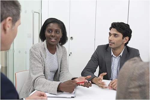 Stock image of people meeting in an office.