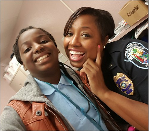 Lt. Hightower of the Hollywood, Florida, Police Department with mentored student in the Cops Mentoring Kids program.