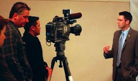 Man Being Interviewed on Camera