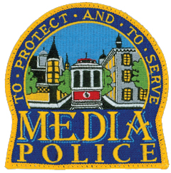 "The borough of Media, Pennsylvania, was incorporated in 1850 and serves as the seat of government for Delaware County. Located 12 miles west of Philadelphia, the borough is one the few areas in the country that has used the same trolley system continuously since the turn of the 20th century. This still-active trolley is depicted on the patch of the Media Police Department alongside the area's rich Victorian architecture. The depiction also serves as Media's seal, which proudly states the borough is ""Everybody's Hometown."""