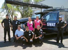 San Miguel de Allende police officers viewing the Armarillo Police Department's SWAT van during a summer 2010 exchange program between West Texas A&M University and the San Miguel de Allende Police Department and city council.
