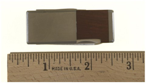 This metal money clip conceals a blade, nail file, and scissors. Offenders may attempt to use it against law enforcement officers.