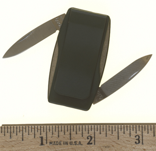 This object appears to be a money clip, but actually houses a knife blade and nail file.