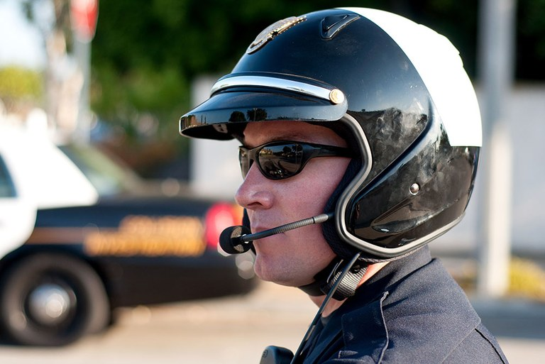 A stock image of a police officer wearing a police motorcycle helmet.